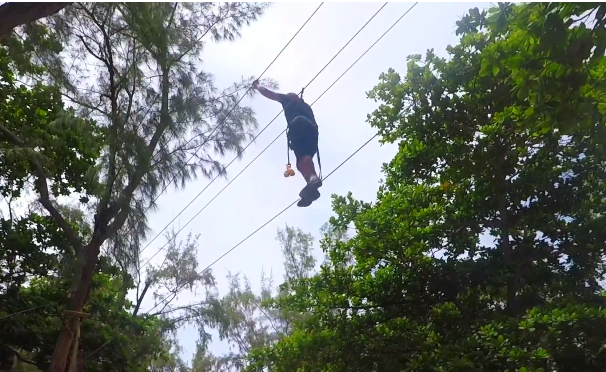 Guy doing zipline during a visit to ile aux cerfs island in Mauritius