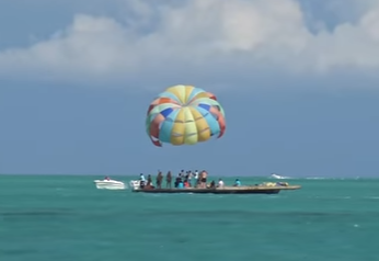 parasailing customers on at platform at Trou-aux-cerfs