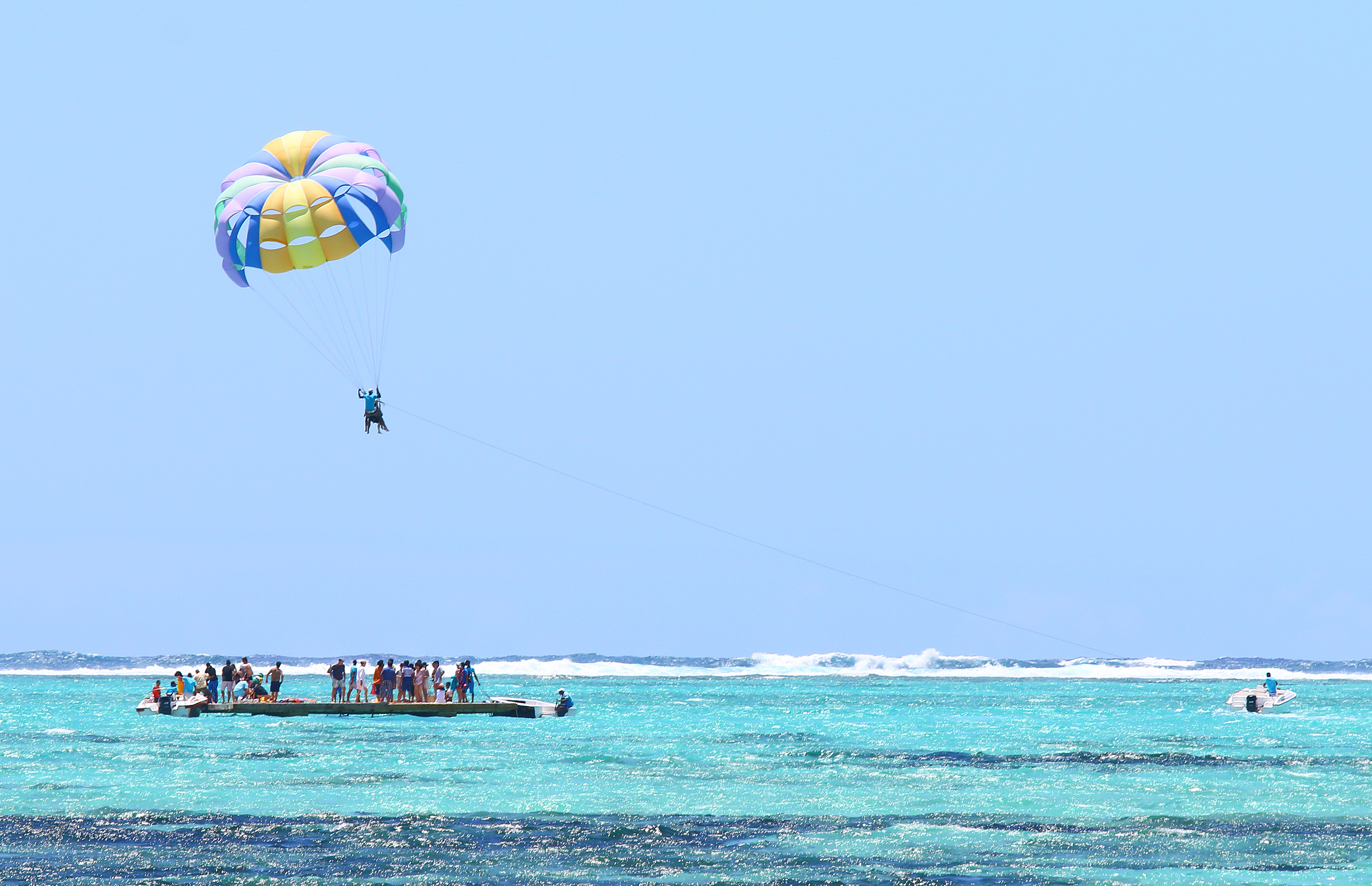 Parasailing at Ile aux cerfs showing platform with tourists and a parasail