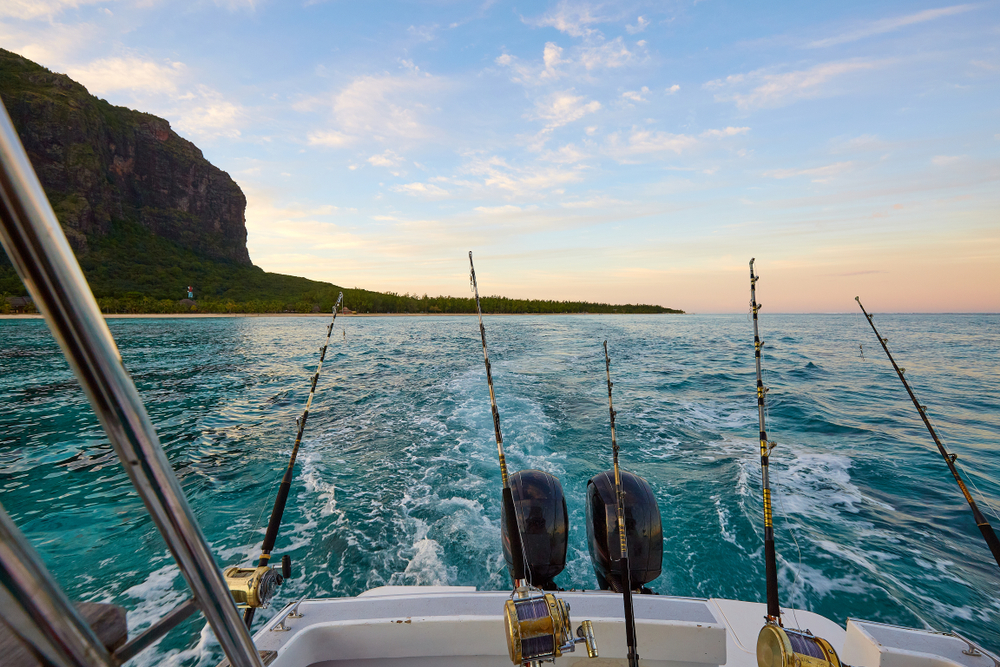 Fishing vessel trolling during a big game fishing trip at Tamarin in Mauritius