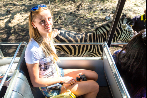 Girl sitting in a safari tour at Casela Mauritius
