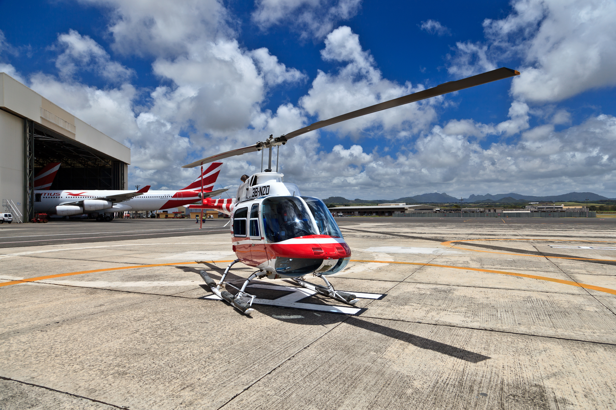 Air Mauritius helicopter preparing to transfer tourists from Airport to hotel